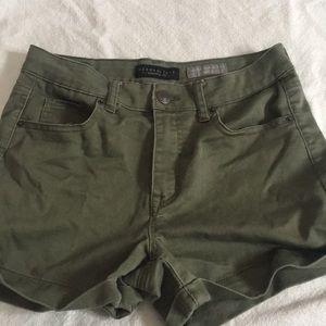 High waisted dark green shorts
